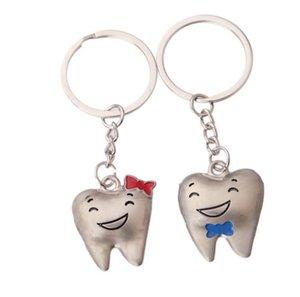 Mayoristas dientes de la historieta del dentista y estaran en 2 pcs = 1 Par Decoración clave de dientes de acero inoxidable modelo dental Clínica regalo Cadenas