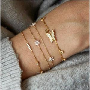 Il braccialetto mette 4 PCS gioielli a catena dei braccialetti della catena del fiore della farfalla per le ragazze / signore / donne