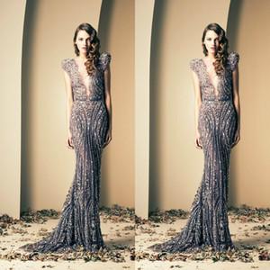 Sirena elegante Vestidos de noche largos Sheer Deep V Neck Lentejuelas sin mangas Apliques Sweep Train Vintage Fiesta formal Vestidos de fiesta