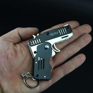Todos metal mini pode ser dobrado como um brinquedo de presente chave anel elástico arma infantil seis explosões de arma de brinquedo pistola de brinquedo de borracha