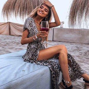 Playa de las mujeres bordea a las mujeres atractivas de la manera se viste de Ladys de manga corta estampado de leopardo Faldas V-cuello irregular Resort Beach falda 2020 nuevo estilo