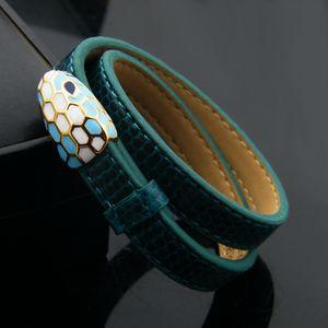 Doble de la manera círculo de color pulsera aceite gota cabeza de serpiente de la PU para la joyería chapada en oro de acero de titanio damas