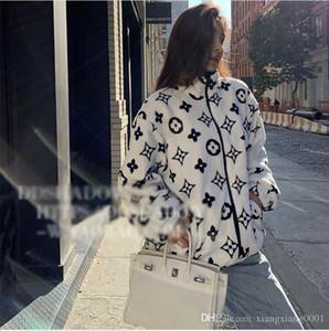 Gli amanti autunno cappotto cappotto invernale femminile coreano sciolto studente cappotto peluche corpo corallo velluto stampa uomini e donne