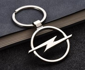 logo 100pcs Styling Nuevo llavero del coche de metal hueco del emblema llavero para Opel Volvo Peugeot Jaguar JEEP FORD VW cadena y anillo titular de la clave