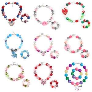 68 Design Baby-Anhänger Chunky Perlen-Halsketten-Armband-Nixe Diamant-Rosen-Kopf-Bogen-Bubblegum Kinder Partei Schmuck M1317
