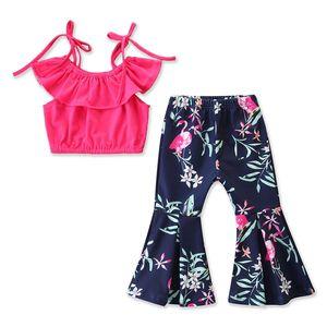 Verano 2019 nuevas prendas para niños, estilo europeo y americano, blusas de color liso + pantalones con botones en la parte inferior de la campana, dos juegos.