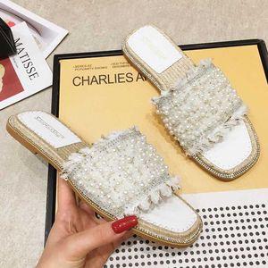 Фея Pearl кристалл открытый носок плоские женщина тапочки летом пляж обувь сандалии женщин скольжения на шариках кисточкой противоскольжения горок 2020