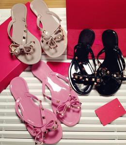 Été femme Tongs Chaussons Sandales plates Bow Rivet Mode Pvc Cristal Chaussures de plage size35-41