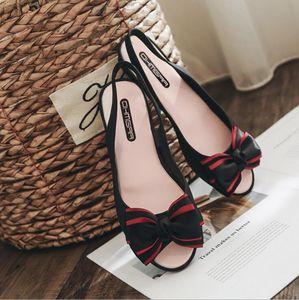 2018 frauen sommer pvc bogen kunststoff sandalen weibliche flache candy farbe jelly schuhe dame mode regen schuhe strand schuhe
