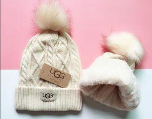 El nuevo sombrero de invierno para las mujeres los hombres del casquillo Pompón Pom Pom Beanie para mujer para hombre de punto Warm Piel Canadá beanies Niño Niña Bobble sombreros de mujer caps8 Adultos