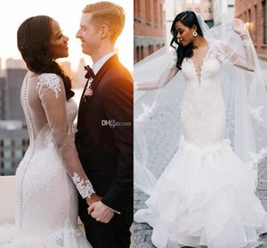African Ivory Mermaid Wedding Dresses 2020 Long Sleeve Sheer Neck Ruffles Appliques African Plus Size Garden Country Bridal Gowns