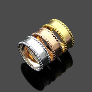 2020 clásico VC * dobles hombres y mujeres de la bola de acero fila anillo de 18 quilates de oro rosa anillo de oro par de flores de regalo de Navidad
