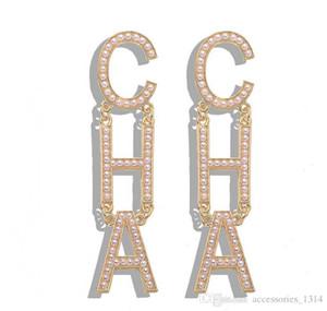 European and American exaggerated street shooting diamond inlaid letter earrings designer asymmetric earrings explosion earrings