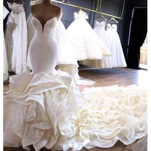 Impresionante tren de capilla larga Vestidos de novia de sirena 2019 Novio con volantes en niveles Vestido de novia modesto Traje de matrimonio árabe nigeriano AL2175