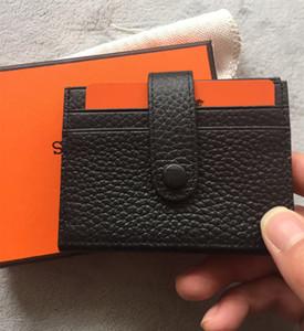 Cartera mágica europea y americana Cartera ultrafina de cuero real Diseño de moda Hombres / Mujeres Titular de la tarjeta de crédito Carteras delgadas con caja