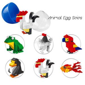 Mini blocos de construção de animais série torção ovos brinquedos 6 estilos pinguim rã cão arara tijolos brinquedos
