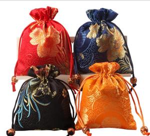 Doppio sacchetto di gioielli con bigiotteria in seta rossa con ornamenti a caso