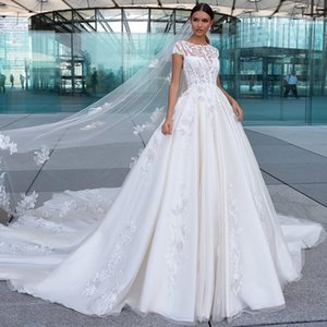 2020 Floral Bridal Dresses Jewel Sleeveless Appliqued Lace Wedding Dress Tulle Court Train Custom Made Vestidos De Novia