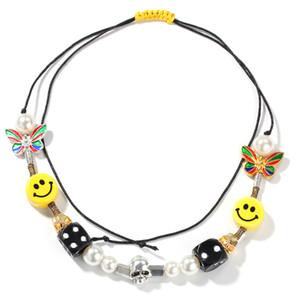 Cara sonriente del collar de Asap Rocky mujeres joyería de la aleación Skull Dice Decoración de la mariposa Y Pera temático regalo de cumpleaños