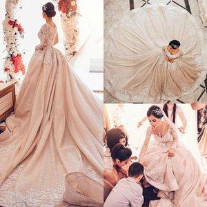 2020 Junoesque Sequined Princess Arabic Dubai Wedding Dresses V Neck Long Sleeve Lace Appliques Long Train Castle Wedding Gown