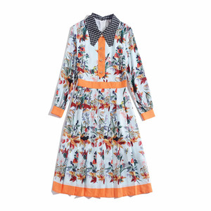 Longueur européenne du genou design rétro station robe florale nouvelle robe d'impression de contraste des femmes au printemps et en été 2020