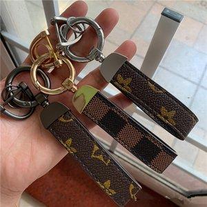 Designer de luxo Keychain PU Chaveiro de couro para as Mulheres Homens Bag Car Key Anel Trinket Landyard Ocultar Corda criativa principal Presentes cadeia de jóias 2020