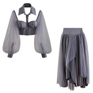Avrupa ve Amerikan kısa waistless yular yaka üç boyutlu göğüs tipi üst + düzensiz orta boy etek takım elbise örgü ızgaradan