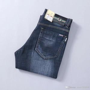Calças masculinas calças de brim soltas estiramento reta tubo de lazer calças novas calças dos homens grandes homens de negócios de tamanho