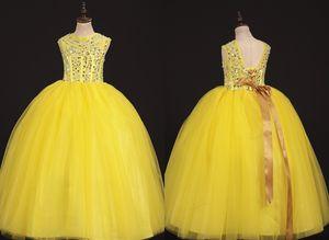 2021 più nuovo giallo a buon mercato bambino bambine bambine abiti da paceant abiti da ballo gioiello collo tulle senza maniche corsetto fiore ragazza prima comunione vestito