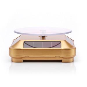 Solarbatterie-Doppelzweck-360rotating Sonnenbrille Display-Plattform mehrfarbige Gläser jewellry Zubehör rotierenden Requisiten Anzeige Schießen