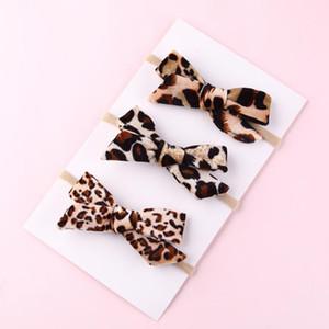 Bandas nueva manera de terciopelo de leopardo vendas para niñas Bowknot Nylon Headwear de los arcos del pelo suave elástico del pelo accesorios para la mujer