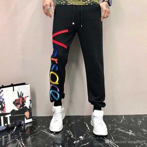 2019 남성 디자이너 캐주얼 땀 바지 조깅 하렘 바지 바지 착용 졸라 매는 끈 플러스 사이즈 솔리드 남성 조깅 바지 슬림 맞춤 팬