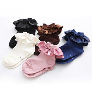 0-7t Niños pequeños Calcetines de algodón con lazo en el tobillo Bebés Niñas Princesa Volantes Calcetines con puños Calcetines de encaje dulce Calcetines para niños