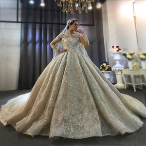 2020 Long sleeves Dubai Luxury Beading Pearls Wedding Dress Puffy Lace Ball Gown with Long Train Custom Made Bridal Gowns