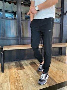 20SS hommes sport pantalon mode PANTALON coton lâche confortable lettres de tissu de haute qualité OEM bouton cargo pantalon faisceau pied