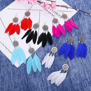 Creative sun flower earrings female and European hot sale long feather earrings bohemian jewelry