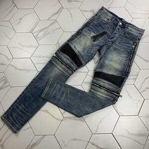 Nueva marca de marea del agujero de estiramiento delgados elásticos pies pantalones bordados de marca de moda para hombre de los pantalones vaqueros de diseño del collage