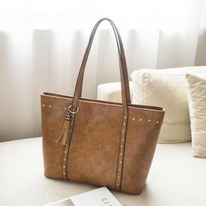 Faux Leather Tassel Bag Wholesale Blanks Rivet bolso con borla de dama de honor regalo monedero envío gratis DOM1061177