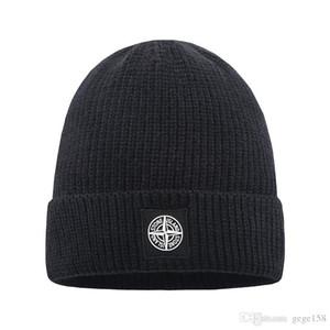 Venda quente Moda Unissex Inverno menss gorro Bonnet womenss lã lã chapéu de tricô hip hop Gorros pom-pom bola de cabelo Crânio de pedra tampão ao ar livre