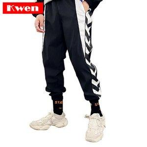 Июнь танцы брюки черной белой полосы Печатный Мужчины Брюки Хип-хоп Гарем Брюки Sweatpants Мужчина Плюс Размер Уличного
