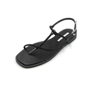 Venda-Roman sandálias Hot fivela palavra com sapatos suaves fundo plano à beira-mar bonita