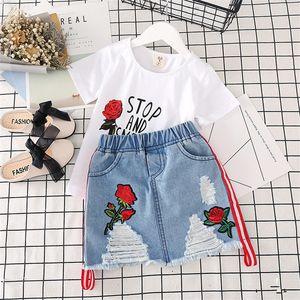 مجموعة جديدة فتاة ملابس أطفال 100٪ قطن قصير كم روز طباعة الفتيات عارضة الصيف فتاة تي شيرت جينز ملابس الاطفال قصيرة يحدد K65