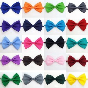 Fornisce 50pcs / set Bow Pet solidi legami di colore Carino cani Gatto cravatta Bambini Bambini Tie decorazioni regolabile 20 Colori HA934