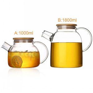 Bollitore in teiera in vetro borosilicato resistente al freddo a caldo Teiera di bambù a duplice uso per le forniture di forniture di caffè all'ingrosso Più nuovo resistente al calore