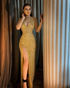 Sparking Gold Sequins Arabic Bling Bling Mermaid Prom Gowns Sexy Halter Backless Evening Dress Formal Party Runway Fashion Dresses