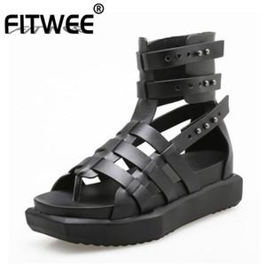 FITWEE Sandal Gladiator réel Véritable Wedges Cuir Rivets Chaussures Vacances d'été Plage Femmes Chic Chaussures Taille 35-40