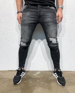 EuropeanAmerican hombres del estilo Medio cintura estiramiento flaco dril de algodón largo de lápiz más el tamaño de los pantalones vaqueros negros cómodas botones S-3XL