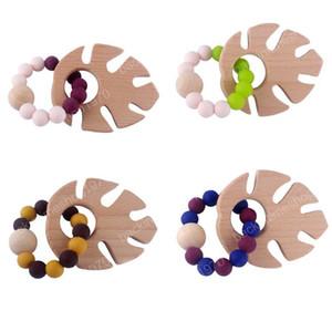 Anneau en bois naturel pour les soins de santé Tétines bébé Accessoires bébé Fingers exercice Jouets colorés Hêtre perlé Apaiser