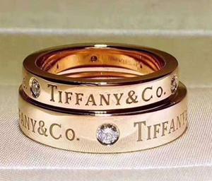 T 커플 반지 티타늄 스틸 세 다이아몬드 클래식 영어 반지 190518014