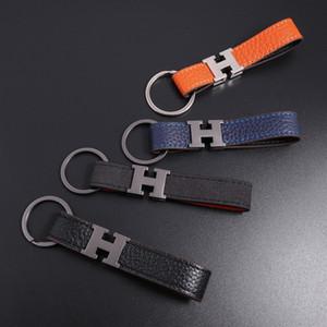 2020 Qualitäts-neue Art und Weise keychain Designer Unisex Schlüsselanhänger aus echtem Leder mit Edelstahl-Schlüsselanhängern mit schwarz in Weißgold Schlüsselring